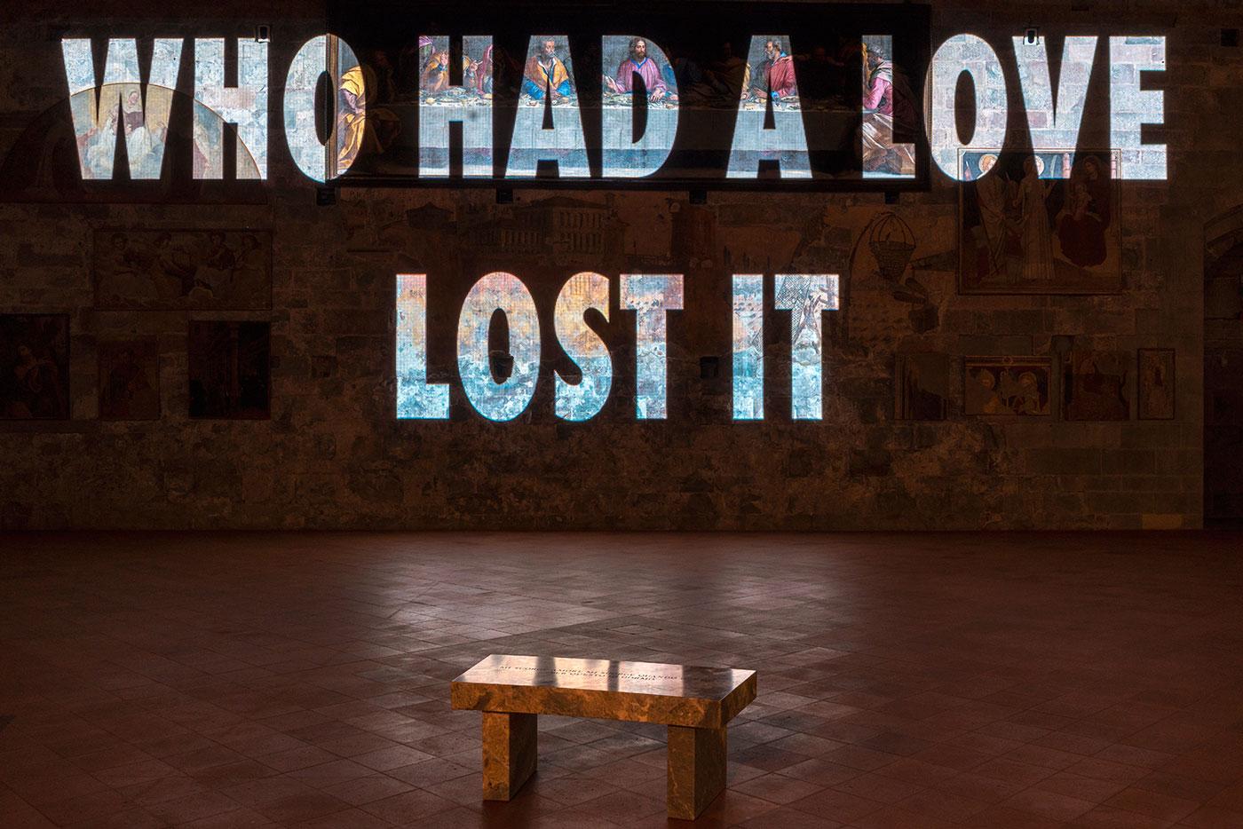 """Dormo, 2019. Curved Versilys Gold marble bench 17 x 41.75 x 18 in. / 43.2 x 106 x 45.7 cm. Text: """"Essere animale per la grazia"""" from Pigre divinità e pigra sorte by Patrizia Cavalli, © 2006 by Giulio Einaudi Editore. Used with permission of the author and the publisher."""